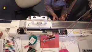 Hacked knitting machine with ayab to connect the knitting machine to the computer