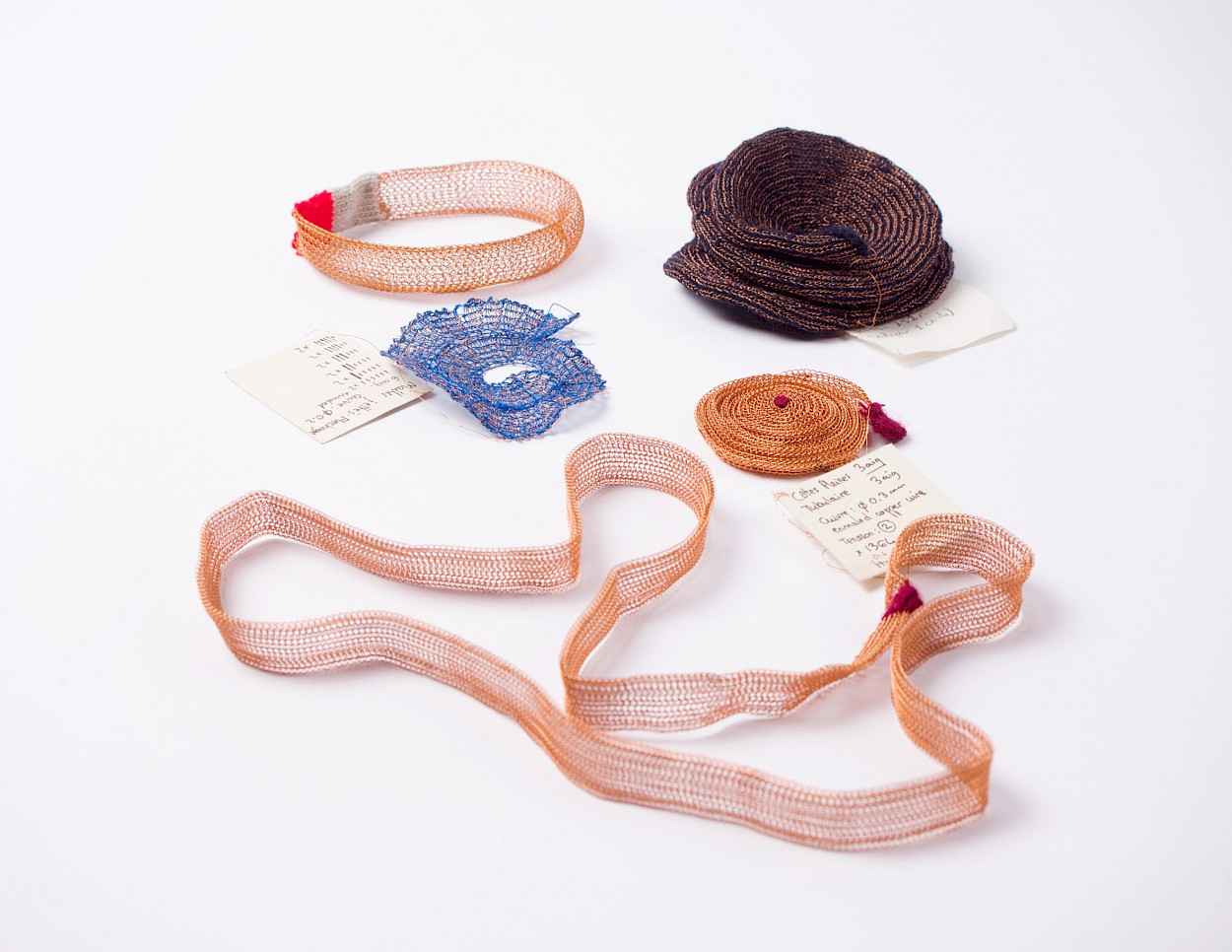 Knitted coils